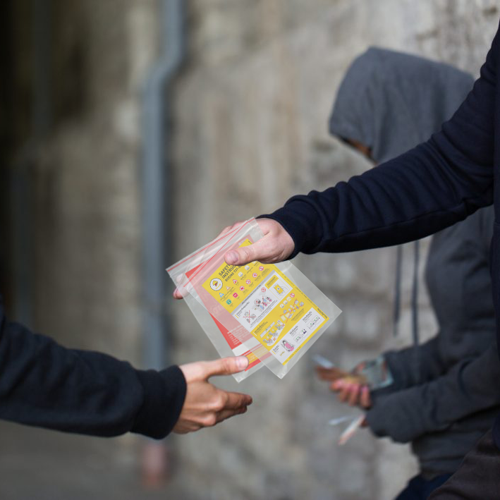 drug deal in alley way with safety cards
