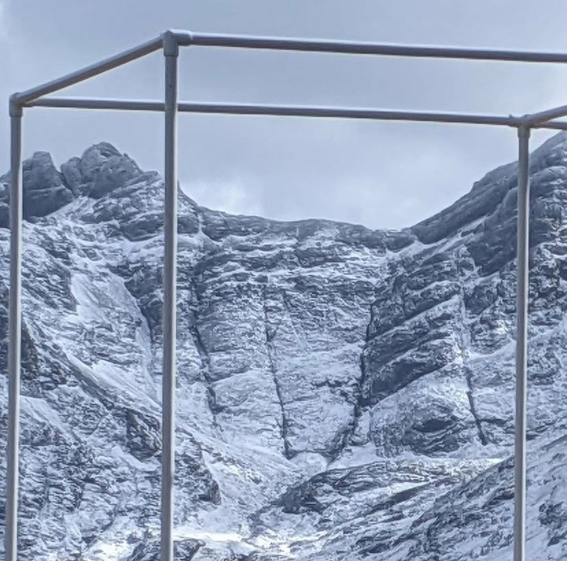 portable bus stop with cuillin mountains behind