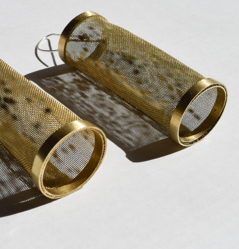 brass earrings, made from wire and woven wire mesh with light reflecting from the surface.